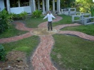 Curtis in the brick garden path he built